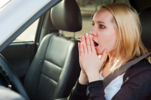Young blonde student girl panic in a car